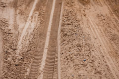 Tire tracks on the ground. Off road 4X4 wheel tracks on country desert beach road sand motoring background image Royalty Free Stock Photography