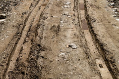 Tire tracks on muddy dirt road Royalty Free Stock Photos
