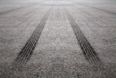 Tire Tracks On The Road Stock Photos