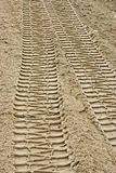 Tire tracks on sand Royalty Free Stock Photos