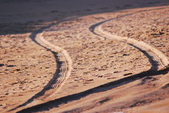 Tire tracks on sand Royalty Free Stock Photography