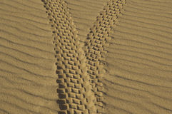 Tire tracks in sand Stock Photography