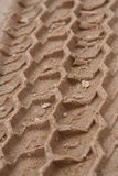 Tire tracks in sand. Close-up of tire tracks in sand Royalty Free Stock Image
