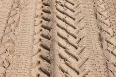 Tire Tracks in Sand Royalty Free Stock Images