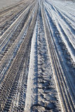 Tire tracks on sand. Multiple tire tracks on the sand, leading away from the viewer Royalty Free Stock Image