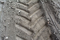 Tire tracks in the sand Stock Images