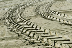 Tire tracks in the sand Royalty Free Stock Photography