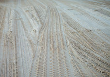 Tire tracks on the sand Stock Images