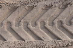 Tire tracks on the sand Royalty Free Stock Photo
