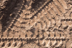 Tire tracks in the sand Stock Photography