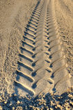 Tire tracks of excavator in sand Royalty Free Stock Photography