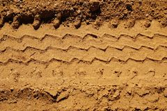 Tire tracks in the sand. Royalty Free Stock Photo