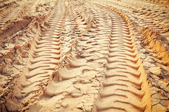 Tire tracks on the sand. Royalty Free Stock Photography