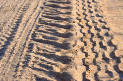 Tire tracks on a sandy road Stock Photography