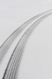Tire tracks in snow Royalty Free Stock Image