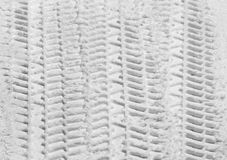 Tire tracks in snow Royalty Free Stock Images