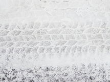 Tire tracks in snow Royalty Free Stock Photo