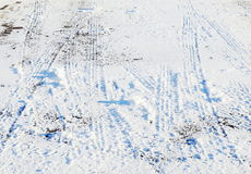 Tire tracks in snow Stock Images