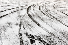 Tire tracks in the snow-covered ground Royalty Free Stock Photography