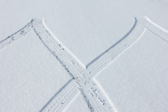 Tire tracks in the snow Stock Images