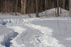 Tire Tracks Through Snow Stock Photography