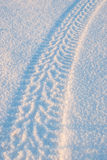 Tire tracks on the snow 01 Stock Photos
