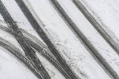 Tire tracks on snowy road. In winter Stock Photo
