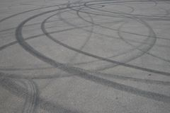 Tire tracks. wheel track on asphalt road. asphalt with traces of car wheels. Traces of braking from rubber tyres on cement. Abstra royalty free stock image