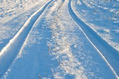 Tire tracks in the winter snow. Tire tracks in the winter snow stock photography