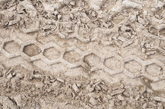 Tire trail on a dirt road. Pattern Stock Photo