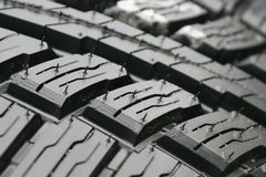 Tire tread. A macro view of the tread of a brand new tire Royalty Free Stock Photo