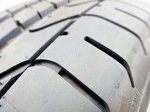 Tire tread closeup in tire shop Stock Photos