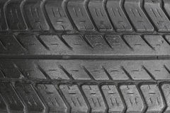 A tire tread, closeup view. A tire tread used. Texture, background Stock Images
