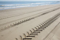 Tire tread footprints of a tractor on the sand Stock Photography