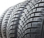Tire Treads. Studded tires new car side photo Royalty Free Stock Photography