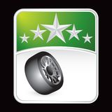 Tire under green star background Royalty Free Stock Photography