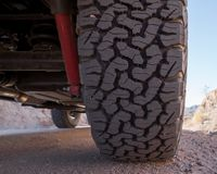 Tire on a 4x4 off road vehicle in the desert stock images