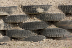 Tire wall. Worn tires stacked up a at race track Stock Photos