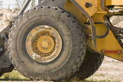 Tire and wheel. A close up of a tire and wheel from a front-end loader Royalty Free Stock Photos