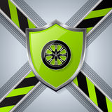 Tire and wheel background with shield Royalty Free Stock Images