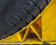A tire on a wheel stop stock photography