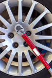 Tire with wheel torque wrench. Changing tire with wheel torque wrench Stock Photo