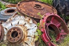 Tire Wheel Weights. Old and rusted pile of agricultural tire wheel weights in a dump but normally used for added traction on large tractors royalty free stock image