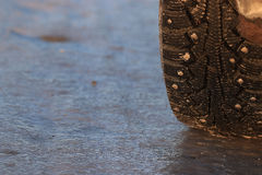 Tire wheel winter icy road Royalty Free Stock Photos