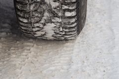 Tire for winter and its imprint on the road covered with snow. Tire for winter with spikes and its imprint on the road covered with snow royalty free stock photos