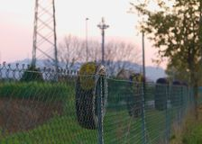 Tire on the wire mesh fence Stock Photos