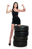Tire and woman Royalty Free Stock Photo