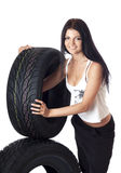 Tire. Young sexy girl holding a car wheel, isolated on white Stock Images