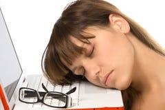 Tired. Girl is sleeping on laptop Stock Photo