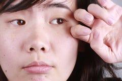 Tired. Girl rub her eye Stock Photography